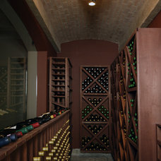 Traditional Wine Cellar by Orren Pickell Building Group