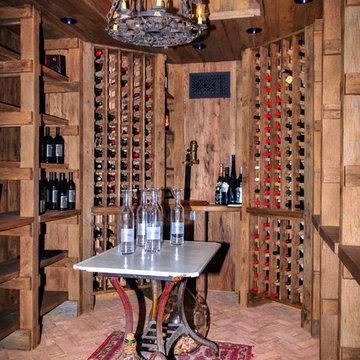 Wine Cellar with Reclaimed Oak walls, ceiling & shelving & Brick Floor