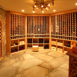 Design ideas for a classic wine cellar in New York with storage racks.