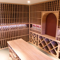 traditional wine cellar by The Magnum Company Inc