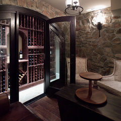 traditional wine cellar by Rule4 Building Group