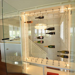 Photo of a small modern wine cellar in Gold Coast - Tweed.