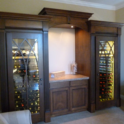 Inspiration for a mid-sized craftsman carpeted and beige floor wine cellar remodel in San Francisco with storage racks