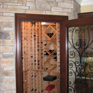 Large mountain style wine cellar photo in Cincinnati with storage racks