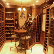 Traditional Wine Cellar by Atlantic Construction Consulting