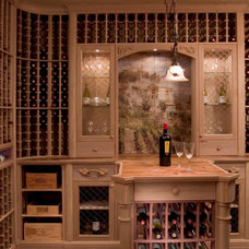 traditional wine cellar by Roger Turk/Northlight Photography