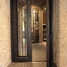 Contemporary Wine Cellar by Kasper Custom Remodeling, LLC