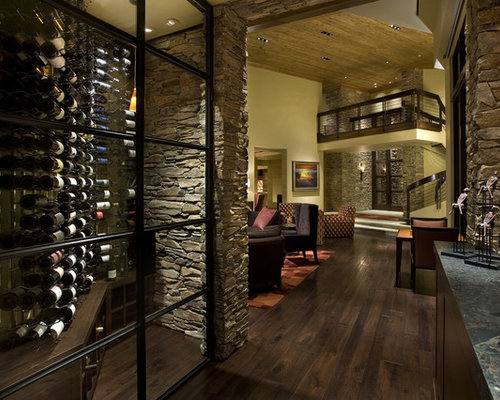 Modern Wine Cellar Dunedin Inspiration for a small contemporary wine cellar remodel in Other with dark hardwood floors and display