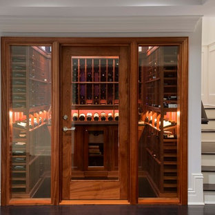 Example of a small classic black floor wine cellar design in New York with display racks