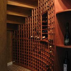 Traditional Wine Cellar by Trade Mark Design & Build
