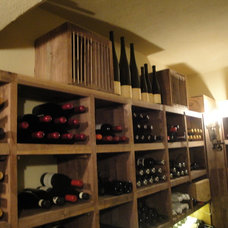 Traditional Wine Cellar by Collinas Design & Construction