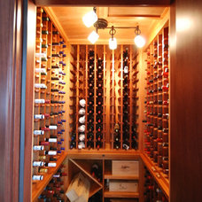Traditional Wine Cellar by Priebe's Creative Woodworking