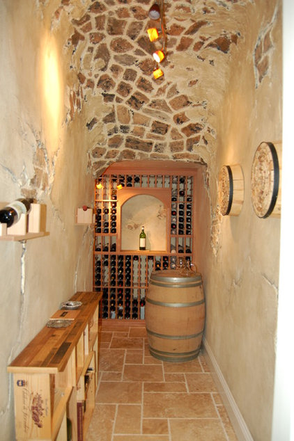 mediterranean wine cellar by Veranda Homes