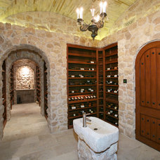 Traditional Wine Cellar by V.I.Photography & Design