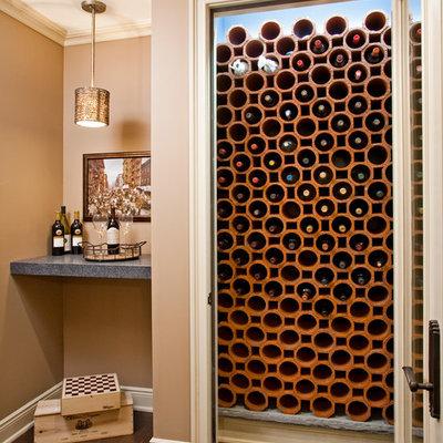 Wine cellar - traditional dark wood floor wine cellar idea in Philadelphia with storage racks