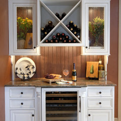 traditional wine cellar by Kitchens Unlimited- Karen Kassen, CMKBD