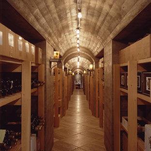 Wine cellar - huge industrial concrete floor wine cellar idea in Seattle