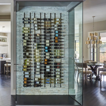 Wine Wall with Glass Walls and Stacked Stone Tile Backsplash