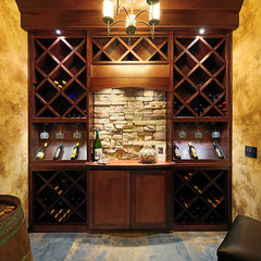 mediterranean wine cellar by Signature Custom Homes