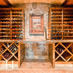 Inspiration for an expansive classic wine cellar in Dallas with brick flooring and storage racks.