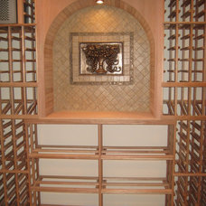 Traditional Wine Cellar by Airhart Construction
