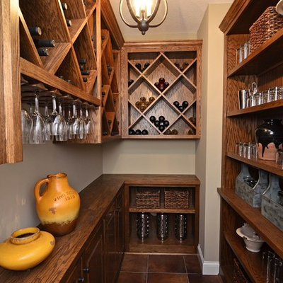Inspiration for a small timeless brown floor wine cellar remodel in Minneapolis with diamond bins