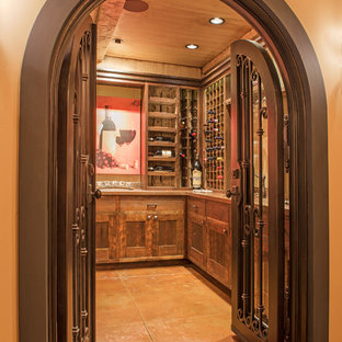 This is an example of a rustic wine cellar in Other with laminate floors, display racks and multi-coloured floors.
