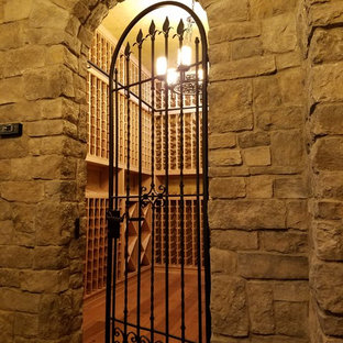 Design ideas for a medium sized classic wine cellar in Other with storage racks, medium hardwood flooring and beige floors.