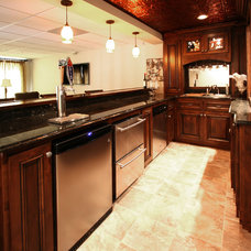 Traditional Wine Cellar by Walker Woodworking