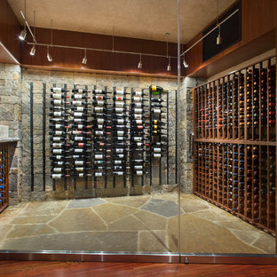 Inspiration for a contemporary brown floor wine cellar remodel in Denver with storage racks