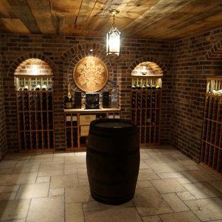 Foto de bodega contemporánea, de tamaño medio, con botelleros, suelo de baldosas de cerámica y suelo beige
