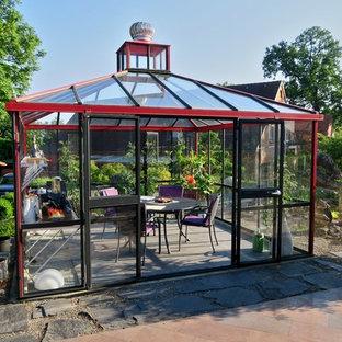 Mittelgroßer Klassischer Wintergarten mit Betonboden und Glasdecke in Bremen