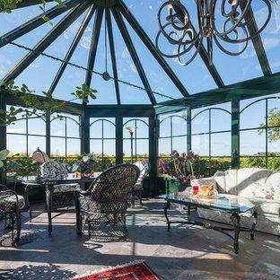 Mittelgroßer Klassischer Wintergarten mit Glasdecke und grauem Boden in Sonstige