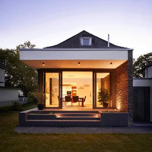 Idées déco pour une véranda contemporaine de taille moyenne avec aucune cheminée, un plafond standard et un sol noir.