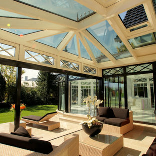 Example Of A Large Ornate Limestone Floor And Brown Floor Sunroom Design In  Frankfurt With A