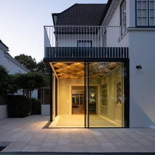 Idéer för små funkis uterum, med klinkergolv i terrakotta och grönt golv