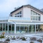 landhaus im taunus farmhouse sunroom berlin by antonius schimmelbusch interior design gmbh. Black Bedroom Furniture Sets. Home Design Ideas