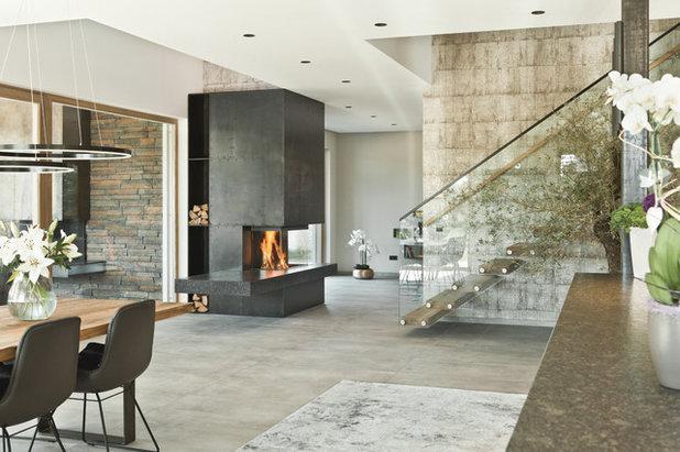 Modern Wohnbereich by Schinharl Ofen- und Kaminhaus GmbH