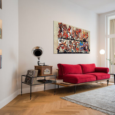 Family room - small eclectic open concept light wood floor and brown floor family room idea in Berlin with a music area and gray walls