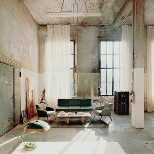 Idee per un grande soggiorno industriale stile loft con sala formale, pareti grigie, pavimento in cemento, nessun camino, nessuna TV e pavimento grigio