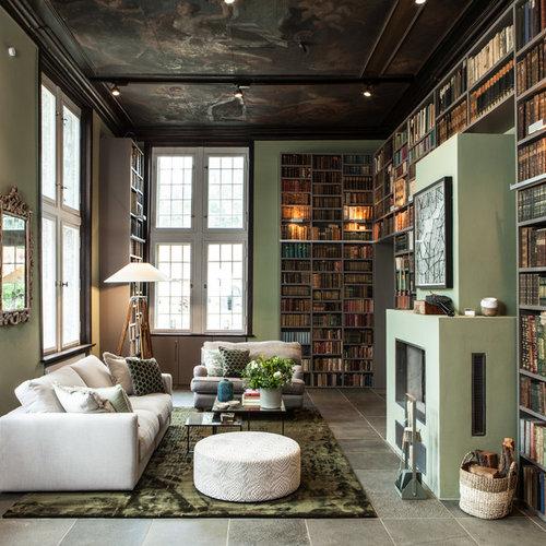 Fernseherlose, Große Moderne Bibliothek Im Loft Style Mit Grüner Wandfarbe,  Verputztem Kaminsims,