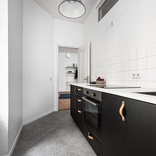 Foto di un soggiorno moderno di medie dimensioni e stile loft con pareti blu, nessun camino, nessuna TV, pavimento in linoleum e pavimento grigio
