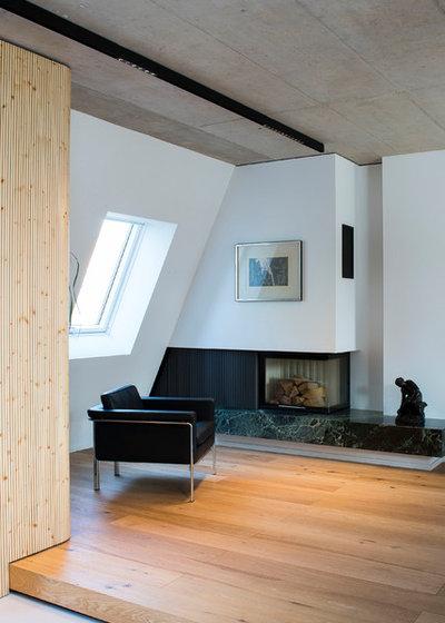 Minimalistisch Wohnzimmer by Bachmann Badie Architekten