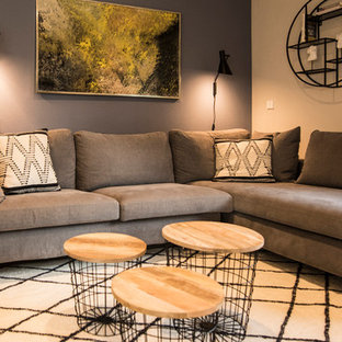 Inspiration for a medium sized contemporary formal open plan living room in Munich with blue walls, ceramic flooring, a standard fireplace, a plastered fireplace surround, a wall mounted tv and beige floors.