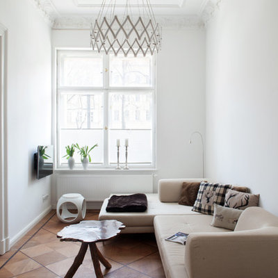 Inspiration for a small eclectic enclosed medium tone wood floor family room remodel in Berlin with white walls, no fireplace and a wall-mounted tv