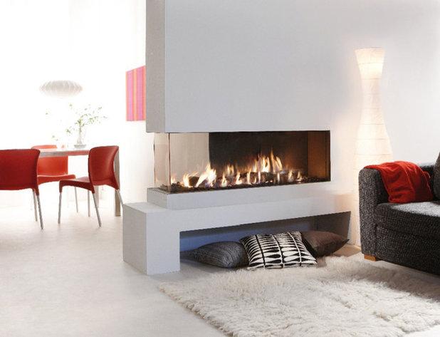 Modern Wohnbereich by Kaminfeuer GmbH
