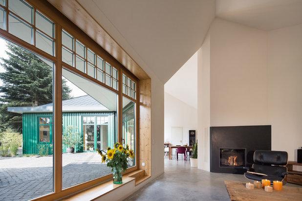 Modern Wohnbereich by Atelier ST