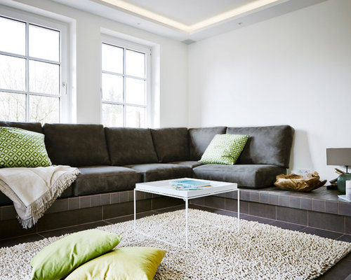 Mid Sized Trendy Formal Living Room Photo In Other With White Walls And Ceramic Floors