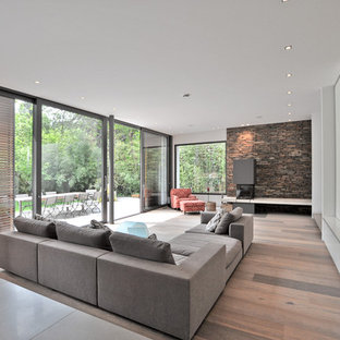 Inspiration for a large contemporary open plan living room in Cologne with painted wood flooring and a wall mounted tv.