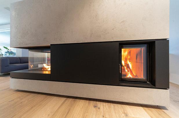 Modern Wohnbereich by Ernst Ofenbau